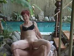 Hot mature jumps on cock near pool