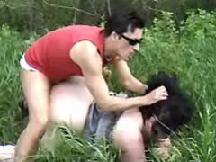 Dude fucks brunette BBW in nature