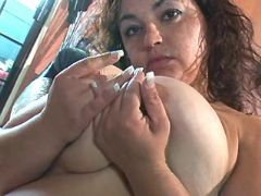 Teen fatty plays with massive boobs