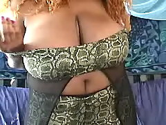 Ebony fat mom shows her greasy body