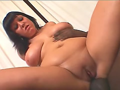 Obese vixen plays w big black dick