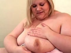 Chubby mature plays with huge boobs