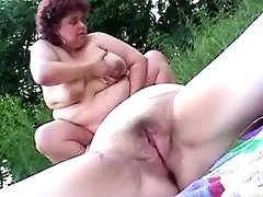 Chubby young lesbians dildofuck each other in bed