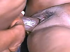 Paunchy ebony woman fucks with guy